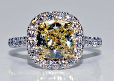 Yellow Diamond Ring  Yellow Diamond Ring in 18K White Gold with a 2.21 ct Fancy Yellow Diamond Center Stone and .75 ctw Diamond Side Stones. Stock # 73-00301 $23,500