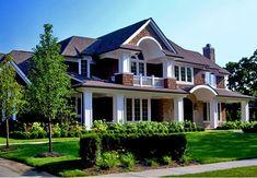 Ассиметричный двухэтажный кирпичный дом в английском стиле с террасой