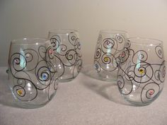 painted wine glasses with swirls and Swarovski crystals