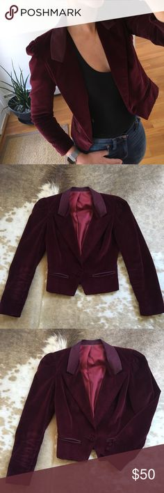 "Vintage Velvet Cropped Blazer Jacket Maroon Wine Vintage jacket in very good vintage condition. Velvet with satin lapels and single button closure. Satin lining. Fits a size 0 best. It's too small on me. Puffed shoulders and cropped shape. No major stains or noticeable damage. Looks great. It is vintage however so may have signs of wear. 20"" long, 13.5 from shoulder seam to shoulder seam across the top, 16.5 from pit to pit on the interior. Jackets & Coats Blazers"