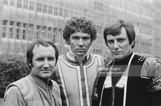 English actors Michael Keating Steven Pacey and Paul Darrow posed together dressed in character...