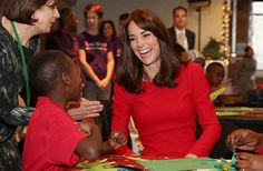 Kate Middleton laughing with youngster