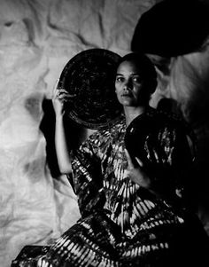 This photograph is from a series of portraits of creative black women by Maud Sulter, who is of Ghanaian and Scottish parentage. The series is called Zabat and shows each woman as one of the nine Greek muses. The word Zabat describes an ancient ritual dance performed by women on occasions of power, and her use of it signifies Maud Sulter's call for a repositioning of black women in the history of photography