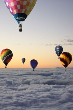 Hot air balloons above the clouds over Michigan
