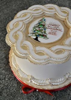 Christmas cake - Royal Icing runout collars, piped border work with piped center medallion.  Hand painted gold accents