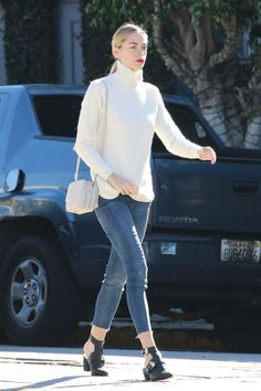 Jamie King looks polished in Mother skinny jeans with a white turtleneck, Sol Sana boots and an eye-catching swipe of red lipstick.
