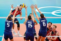 Taylor Sander of USA spikes a ball against