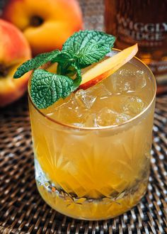 This Bourbon Peach Smash cocktail recipe is a refreshing sip for the dog days of summer! See how easy it is to make this fruity, lightly-spicy bourbon cocktail, made with brown sugar simple syrup. Non-alcoholic variation included in the recipe notes. Bourbon Cocktails, Whiskey Drinks, Peach Vodka Drinks, Liquor Drinks, Refreshing Summer Cocktails, Summer Drinks, Brunch Drinks, Fun Drinks, Craft Cocktails