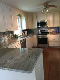My new kitchen - off white cabinets, typhoon Bordeaux granite countertops, bamboo floors