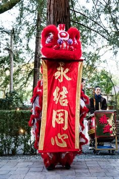 Integrating Chinese culture into a wedding looks like a Lion Dance. It was an awesome way to integrate Courtney's heritage into her wedding day. More details in the blog!