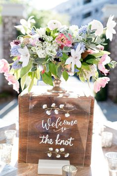 Check out that calligraphy! Yes - that is cotton! Also - The fresh blooms are to die for!!  http://www.macandbevents.com/#!The-Knot-Rocks-Charleston/c24tz/570d26700cf2af49d70eb5ca