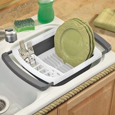 Collapsible Over-the-Sink Dish Rack Extends, then folds flat for storage.  I need this.
