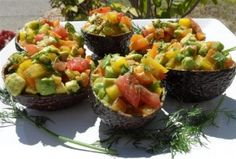 Avocado Boats    If you are transitioning to the raw food diet, avocado is likely a staple in your diet. You can prepare this simple, yet delicious and beautiful dish for any crowd, composed of raw foodists or otherwise.    Ingredients:  4 avocados  2 yellow bell peppers  1 orange/red bell pepper  3-4 medium tomatoes  3 green onions  1 bunch of fresh dill  3 tablespoons sunflower oil, optional  Sea salt to taste, optional