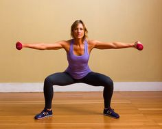 Stand with legs wide and toes pointed outward slightly. Hold a pair of dumbbells in your hands with your ar...