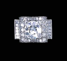A DIAMOND COCKTAIL RING, BY RENE BOIVIN   Set with an old European-cut diamond in a pavé-set twin-arched surround to the baguette-cut diamond shoulders and plain hoop, circa 1935, size 6, with French assay marks  Signed by René Boivin