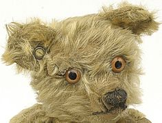 Chad Vallley Teddy Bear 1920's 'Aerolite' covered button with metal rim. Distinctive glass pale orange eyes.
