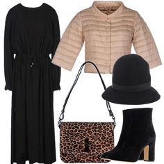Il fluttuante vestito lungo con coulisse è illuminato dal piumino con mezze maniche, accostato agli stivaletti col tacco alto e grosso, la tracolla leopardata e il cappellino con piccola tesa.