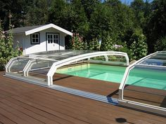 Select high quality polycarbonate retractable swimming pool enclosure and cover products varied in style. There are many reasons to build a aluminum telescopic swimming pool enclosures, retractable swimming pool enclosures UV protection. Swimming Pool Enclosures, Patio Enclosures, Swimming Pools, Spas, Retractable Pool Cover, Exterior, Garden Bridge, Backyard, Ocean