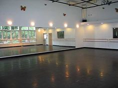 Enchanted Garden Studios' in Ridgefield, CT, includes this 200 sq ft dance studio with floating  Marley surface floor, surround sound audio system, & 30 ft cathedral ceiling. The 25 ft span of windows has view of gardens & stone salt water pool with waterfall.
