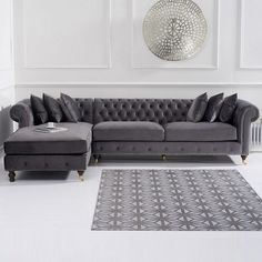Nesta Chesterfield Left Corner Sofa In Grey Velvet And Wooden Legs, featuring a striking Chesterfield-inspired design, adding an elegance and style to any home decor. Upholstered in Grey Velvet wit. Corner Sofa Living Room, Grey Corner Sofa, Corner Sofa Design, Living Room Sofa Design, Living Room Decor Cozy, Home Room Design, Living Room Designs, Chesterfield Corner Sofa, Chesterfield Living Room