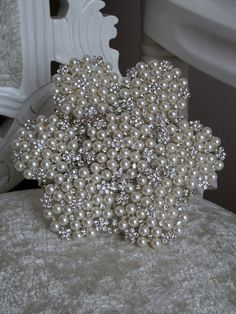 Hand crafted wedding bouquets made from Pearl and Diamante Brooches.  Each brooch bouquet is completely individual, making it a fabulously unique addition to any wedding day!