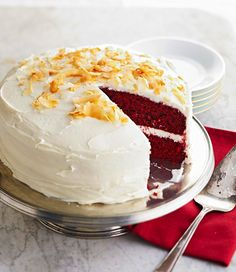 We gussied up chocolate cake mix with sour cream and red food coloring for this festive cake. Then, we crowned the holiday dessert with a white chocolate-cream cheese frosting and toasted coconut. Winter Desserts, Holiday Desserts, Easy Desserts, Ultimate Cake Recipe, Best Dessert Recipes, Cake Recipes, German Chocolate Cake Mix, White Chocolate, Chocolate Frosting