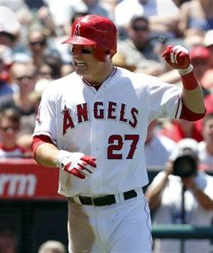 Game #99 7/25/12: Los Angeles Angels' Mike Trout grimaces after getting hit by a pitch from Kansas City Royals' Luke Hochevar in the fourth inning of a baseball game in Anaheim, Calif., on Wednesday, July 25, 2012. (AP Photo/Christine Cotter)