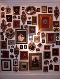 there is something magical about a wall full of frames with vintage photos.... (which all have animal faces) looooooooooooooove this idea!