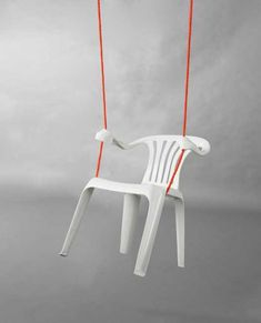 swing made of white plastic chair and rope