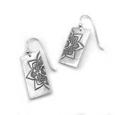 The Mandala, means circle in sanskrit and symbolizes harmony and balance within ourselves and the universe. This unique pair of fine silver dangle earrings sports a beautiful mandala image to help you focus your energy for the day. The earring wires are handmade of sterling