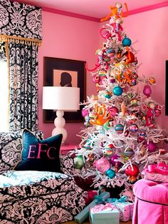 Whimsical Decor - 8 Festive Christmas Tree Themes on HGTV Designer Tobi Fairley decorated a white Christmas tree with colorful, bold ornaments and sock monkeys for a playful spin. Whimsical Christmas Trees, Cool Christmas Trees, Christmas Tree Themes, Noel Christmas, All Things Christmas, Beautiful Christmas, White Christmas, Xmas Tree, Bohemian Christmas