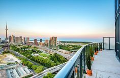 Liberty Central-51 East Liberty St #PH04  | Must see one-of-a-kind 1100 + sf 2 bedroom, 2 bath + den + 2 parking & 2 lockers Penthouse curve suite with fab pano CN tower/city/lake views! . Also includes 2 premium parking/storage locker combo units on P1. More info here: torontolofts.ca/liberty-central-lofts-for-sale/51-east-liberty-st-ph04 Lake View, Lofts, Cn Tower, Railroad Tracks, Lockers, Den, Locker Storage, Liberty, The Unit