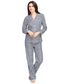 Our pajamas are crafted from cotton poplin for a soft handfeel. Trimmed with white piping at the collar, lapel, pocket and sleeves. Elastic waistband with self-fabric drawstring. Gingham pattern. Machine wash. Imported.