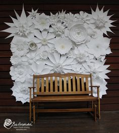 Handmade white paper flowers create a stunning textural backdrop.