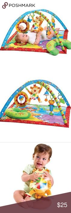 Tiny Love baby gym, Monkey Island This playmat has so many activities to engage your baby! The mat is fun & colorful, & the arches snap inside the flaps on each corner of the mat. The arches have multiple snaps on them, so you can snap them together to cross over at a variety of heights. The accessories click into the holes In the arches to dangle over the child, & the mirror fastens directly onto the mat. Add batteries to the monkey for music & lights! See pix for details of wear (please…