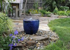 A backyard fountain makes a big impact on a small garden. The sound of the water is lovely.