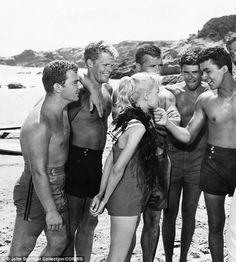 Surfer girl: Sandra surfs her way into the heart of handsome James Darren (right) in the perrenial teen favorite Gidget.