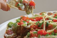 My Mexican Dip recipe makes clever use of substitutes to lower the total fat count of this recipe and the good news is no one will know the difference. Mexican Dip Recipes, Mexican Dips, Ethnic Recipes, Appetizer Dips, Appetizer Recipes, Hot Salsa, Good Food, Yummy Food, Corn Chips