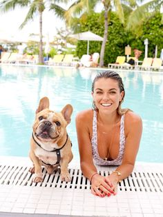 """Say cheese! """"Graceland"""" actress Serinda Swan was all smiles while posing for a picture with her dog on vacation in Miami on Feb. 6, 2015. Don't forget your SPF."""