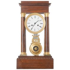 French 19th Century Empire Mahogany Table Clock | From a unique collection of antique and modern clocks at https://www.1stdibs.com/furniture/decorative-objects/clocks/