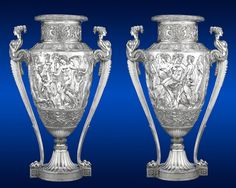 A monumental pair of solid silver vases Continental mid 20th century. Each 45 inches (115cm) tall