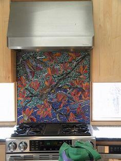 Mosiac backsplash by AWorkofArtStudio, via Flickr.  Windows under cabinets.