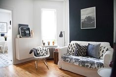 park slope studio with a black accent wall. or very dark gray?
