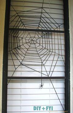 DIY yarn spider web window decoration for #Halloween