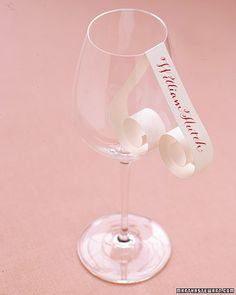 Curled Place Cards    For just a hint of romance, create these place cards using quilling paper and hang them over wine glasses to identify guests' seats.