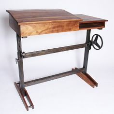 An adjustable height stand-up desk, so we can work on our feet.  Standup Desk, Walnut  Steel