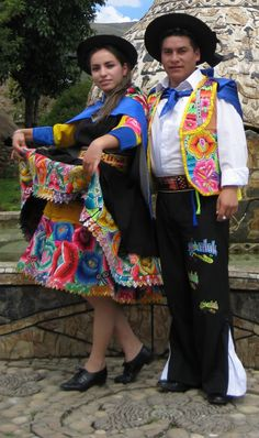 Couple dressed in traditional Huancayo-Peru festive garments to dance Huaylash, which means youth dance. Love the brilliant embroidery and colors. Huancayo is my mother's hometown.