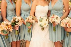 I love these bridesmaids bouquets in soft peaches and apricots with succulents, perfectly tones with the dresses. three sisters