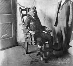CAPITAL PUNISHMENT: Awaiting Execution by Electrocution A man strapped into an e. CAPITAL PUNISHMENT: Awaiting Execution by Electrocution A man strapped into an electric chair awaits his execution by electrocution.