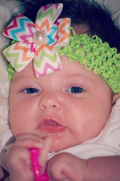 Paisley is wearing another PaisleyGirl Bows! Such a beautiful little girl!  This headband can be purchased for $2.92 tax included and the daisy can be purchased for an additional $3.18 tax included. This headband is also interchangeable so additional bows, whether it be more daisies or shabby chic bows, can be purchased and be worn with the headband. Little babies love them because they don't feel tight on their head or leave indentations! Go to http://etsy.com/shop/paisleygirlbowsllc